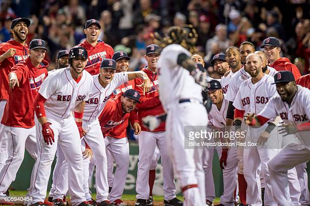 Hanley Ramirez of the Boston Red Sox is mobbed by teammates after hitting a walk off three run home run during the ninth inning of a game against the...