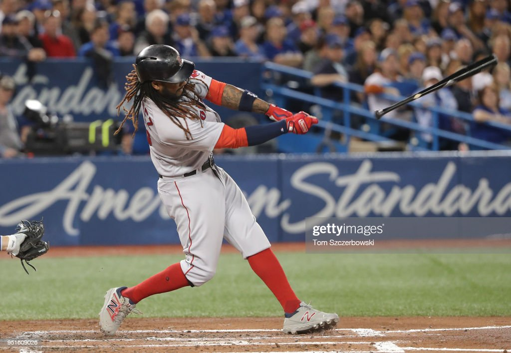 Hanley Ramirez #13 of the Boston Red Sox loses his grip on his bat as he swings in the third inning during MLB game action against the Toronto Blue Jays at Rogers Centre on April 26, 2018 in Toronto, Canada.