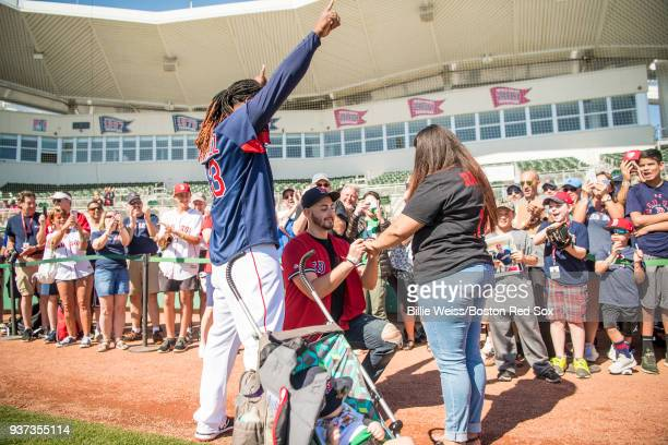 Hanley Ramirez of the Boston Red Sox participates in a marriage proposal for fans during a team workout on March 24 2018 at Fenway South in Fort...
