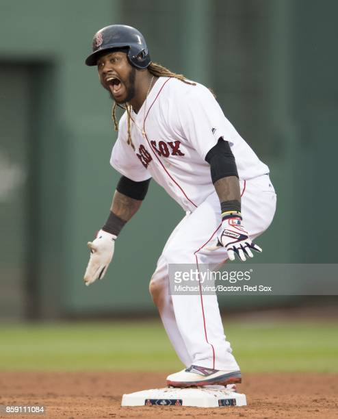 Hanley Ramirez of the Boston Red Sox reacts after a tworun double against the Houston Astros in the seventh inning of game three of the American...