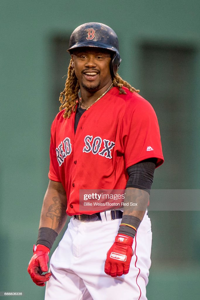 Hanley Ramirez #13 of the Boston Red Sox reacts after hitting a double during the second inning of a game against the Seattle Mariners on May 26, 2017 at Fenway Park in Boston, Massachusetts.