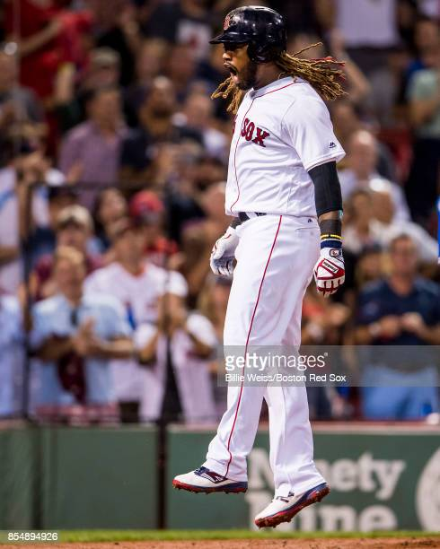 Hanley Ramirez of the Boston Red Sox reacts after hitting a solo home run during the third inning of a game against the Toronto Blue Jays on...