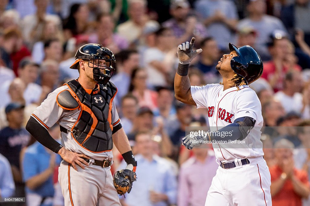 Hanley Ramirez #13 of the Boston Red Sox reacts after hitting a three run home run as Matt Wieters #32 of the Baltimore Orioles looks on during the third inning of a game on June 15, 2016 at Fenway Park in Boston, Massachusetts.