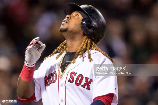 Hanley Ramirez of the Boston Red Sox reacts after hitting a two run home run during the first inning of a game against the Chicago Cubs on April 30...