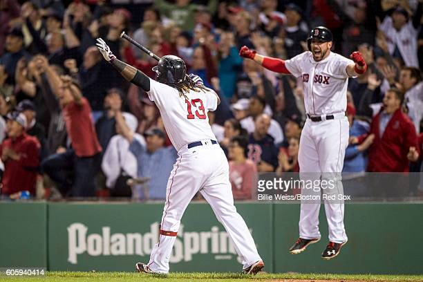 Hanley Ramirez of the Boston Red Sox reacts alongside Travis Shaw after hitting a walk off three run home run during the ninth inning of a game...