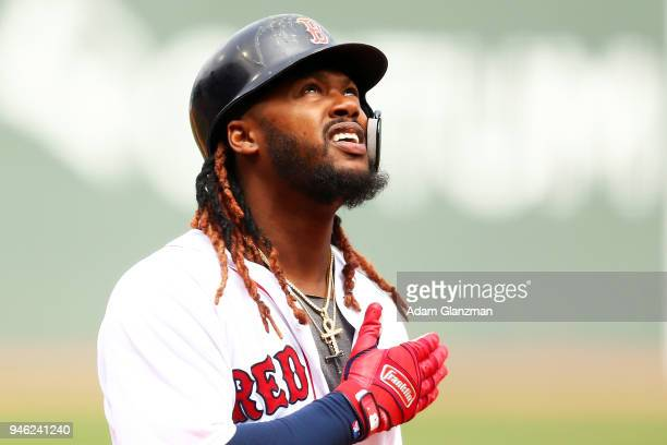 Hanley Ramirez of the Boston Red Sox reacts as he crosses home plate after hitting a tworun home run in the first inning of a game against the...