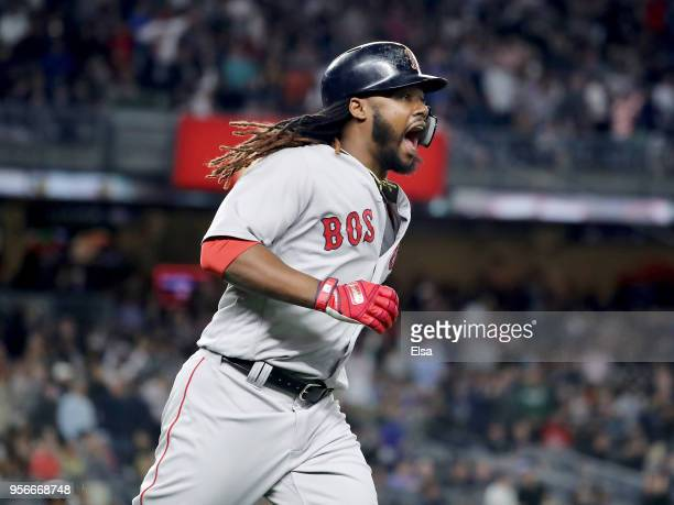 Hanley Ramirez of the Boston Red Sox reacts to his two run home run in the seventh inning against the New York Yankees at Yankee Stadium on May 9,...