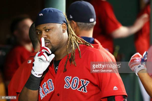 Hanley Ramirez of the Boston Red Sox returns to the dugout after hitting a tworun home run in the third inning of a game against the New York Yankees...