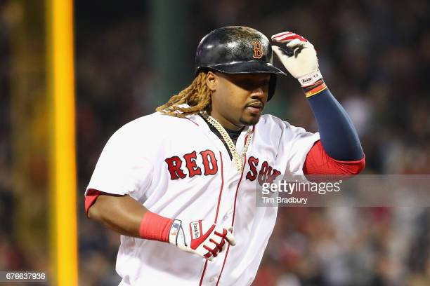 Hanley Ramirez of the Boston Red Sox runs the bases after hitting a solo home run during the fourth inning against the Baltimore Orioles at Fenway...