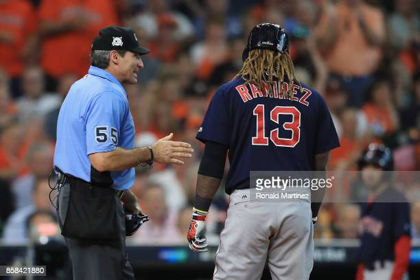 Hanley Ramirez of the Boston Red Sox talks with umpire Angel Hernandez after striking out in the third inning against the Houston Astros during game...