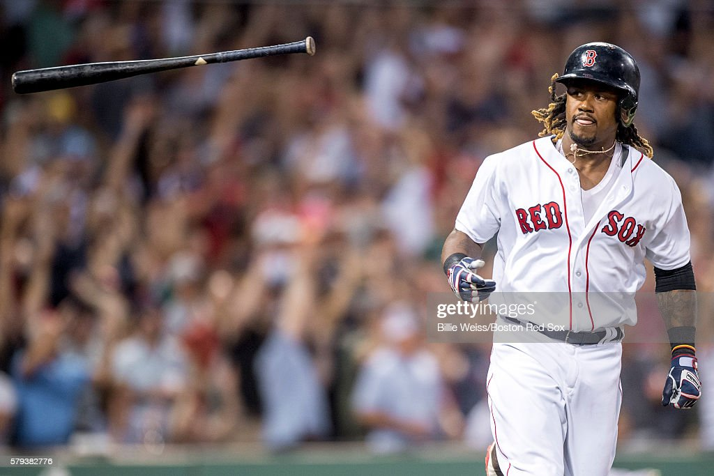 Hanley Ramirez #13 of the Boston Red Sox tosses his bat after hitting a three run home run during the second inning of a game against the Minnesota Twins on July 23, 2016 at Fenway Park in Boston, Massachusetts.