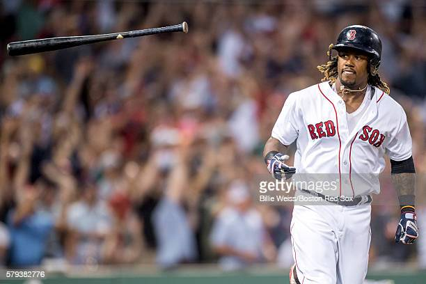 Hanley Ramirez of the Boston Red Sox tosses his bat after hitting a three run home run during the second inning of a game against the Minnesota Twins...