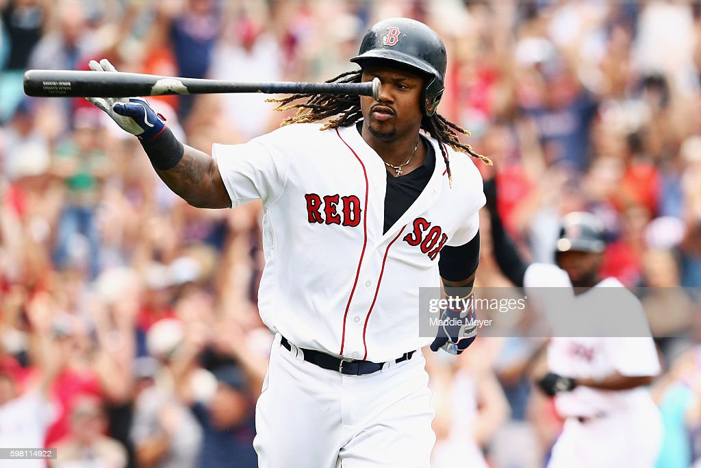 Hanley Ramirez #13 of the Boston Red Sox tosses his bat after hitting a grand slam during the fifth inning against the Tampa Bay Rays at Fenway Park on August 31, 2016 in Boston, Massachusetts.