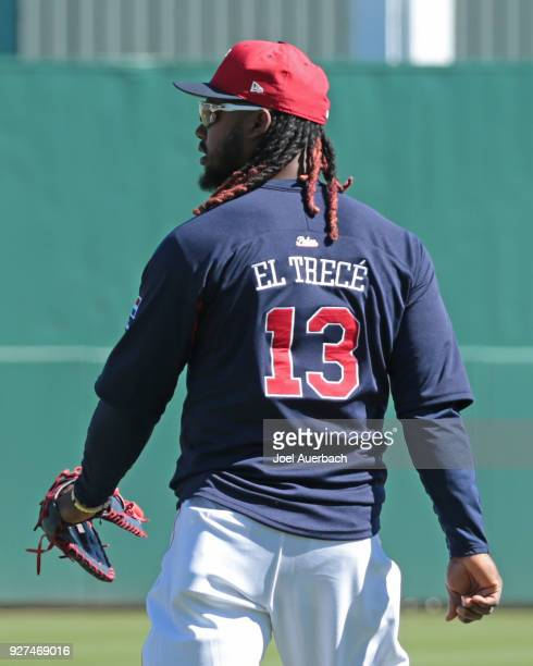 Hanley Ramirez of the Boston Red Sox wears a warm up jersey that states in Spanish 'The Thirteen' prior to the spring training game against the New...