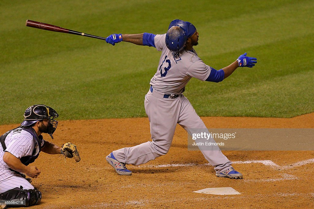 Hanley Ramirez #13 of the Los Angeles Dodgers loses his helmet while striking out during the sixth inning against the Colorado Rockies at Coors Field on September 16, 2014 in Denver, Colorado.