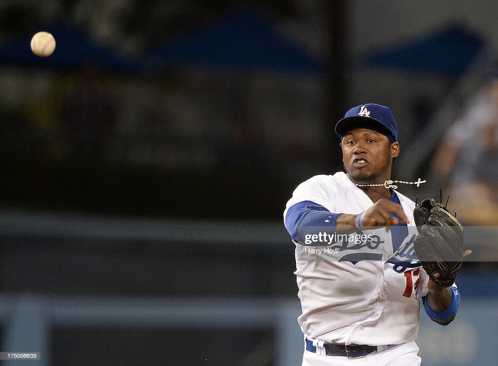 Hanley Ramirez #13 of the Los Angeles Dodgers makes a throw for an out against the Cincinnati Reds at Dodger Stadium on July 26, 2013 in Los Angeles, California.