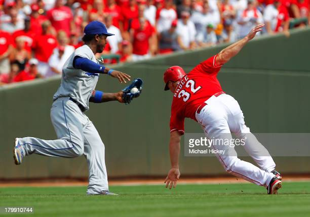 Hanley Ramirez of the Los Angeles Dodgers reaches to tag out Jay Bruce of the Cincinnati Reds in a run down in the bottom of the first inning at...