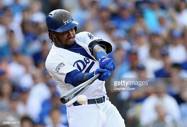 Hanley Ramirez of the Los Angeles Dodgers singles to knock in Yasiel Puig in the third inning of Game One of the National League Division Series at...