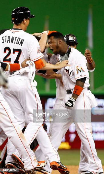 Hanley Ramirez of the Miami Marlins celebrates after hitting the gamewinning home run during a game against the Arizona Diamondbacks at Marlins Park...