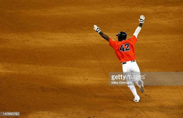 Hanley Ramirez of the Miami Marlins celebrates hitting a bases loaded walk off single in the 11th inning during a game against the Houston Astros at...