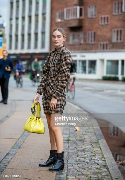 Hanna Baxter is seen wearing plaid dress yellow Ganni bag outside Saks Potts during Copenhagen Fashion Week Spring/Summer 2020 on August 08 2019 in...