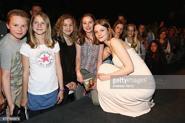 Hanna Binke poses with supporters after the Frankfurt premiere of the film 'Ostwind 2' on May 4 2015 in Frankfurt am Main Germany