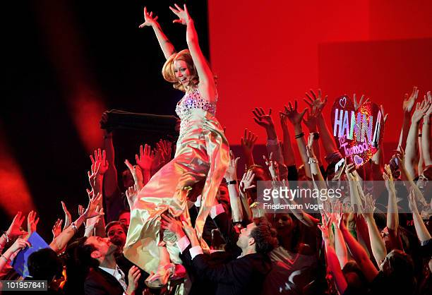 Hanna celebrates during the PRO7 TV show 'Germany's Next Topmodel Final' at the Lanxess Arena on June 10 2010 in Cologne Germany