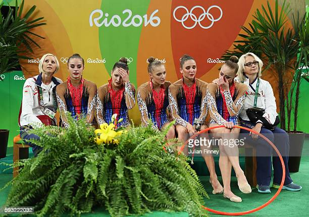 Hanna Dudzenkova Maria Kadobina Maryia Katsiak Valeriya Pischelina and Arina Tsitsilina of Belarus react after placing fifth in the Group AllAround...