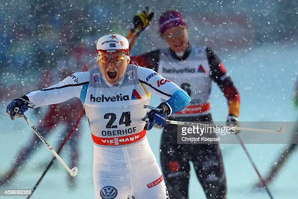 Hanna Erikson of Sweden celebrates winning the Women's 15km final free sprint at the Viessmann FIS Cross Country World Cup event at DKB Ski Arena on...