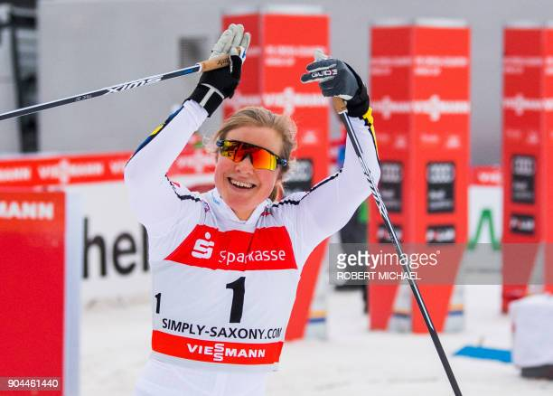 Hanna Falk of Sweden celebrates after winning the women's 12 km sprint quarter final race of the FIS World cup in Dresden eastern Germany on January...