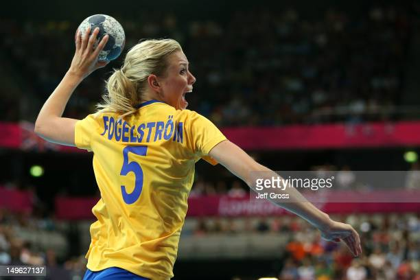 Hanna Fogelstrom of Sweden throws for goal in their Women's Handball Preliminaries Group B match against France on Day 5 of the London 2012 Olympic...