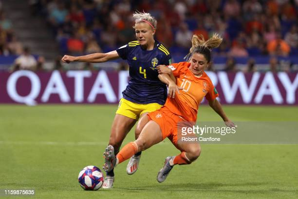 Hanna Glas of Sweden battles for possession with Danielle Van De Donk of the Netherlands during the 2019 FIFA Women's World Cup France Semi Final...