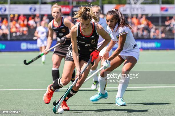 Hanna Granitzki of Germany vies with Ambre Ballenghien of Belgium during the European field Hockey Championship match between Germany and Belgium at...