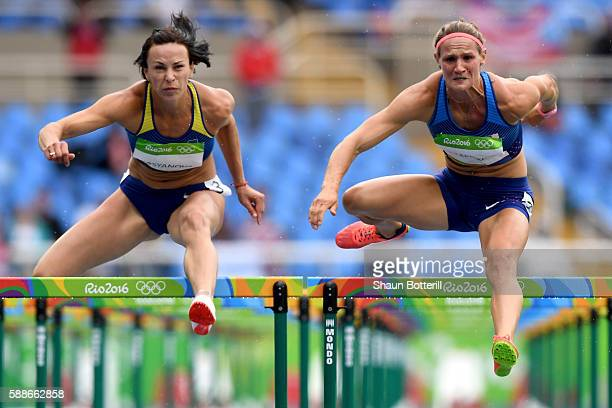 Hanna Kasyanova of Ukraine and Katarina JohnsonThompson of Great Britain compete in the Women's Heptathlon 100 Meter Hurdles on Day 7 of the Rio 2016...