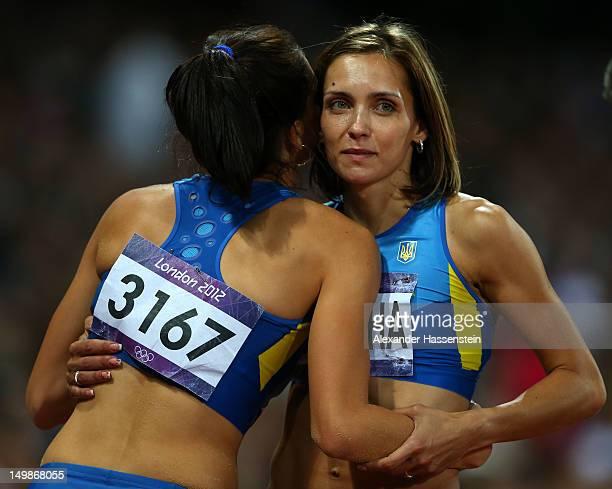 Hanna Knyazyeva of Ukraine hugs Olha Saladuha of Ukraine during the Women's Triple Jump Final on Day 9 of the London 2012 Olympic Games at the...