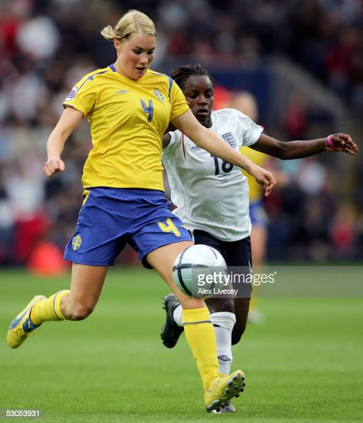Hanna Marklund of Sweden holds off a challenge from Eniola Aluko of England during the Women's UEFA European Championship 2005 Group A game between...