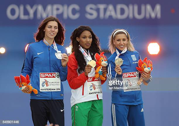 Hanna Minenko of Israel Patricia Mamona of Portugal and Paraskevi Papahristou of Greece celebrate on the podium after receiving their medals from the...