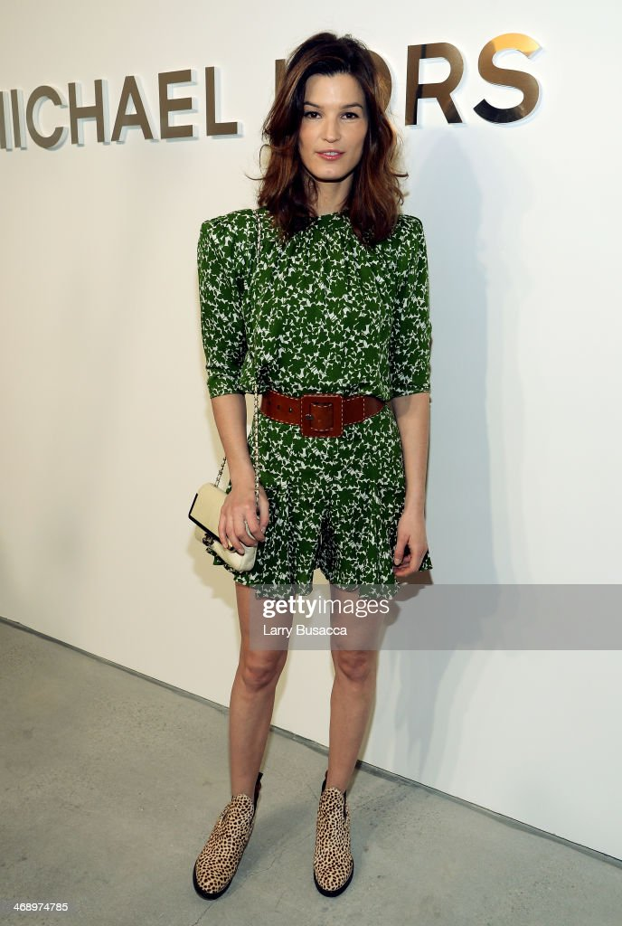 Hanna Mustaparta poses backstage at the Michael Kors fashion show during Mercedes-Benz Fashion Week Fall 2014 at Spring Studios on February 12, 2014 in New York City.