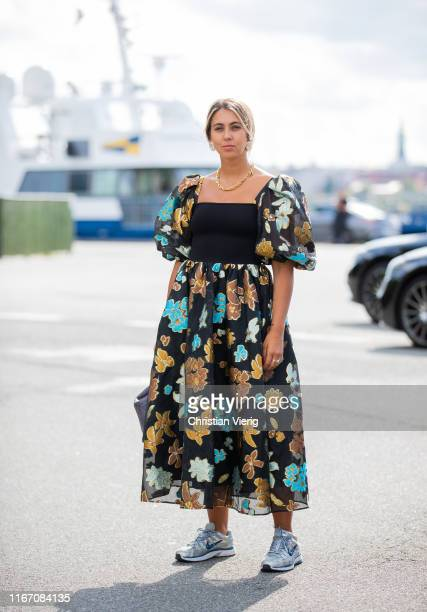Hanna Mw is seen wearing dress with floral print outside Stine Goya during Copenhagen Fashion Week Spring/Summer 2020 on August 08, 2019 in...