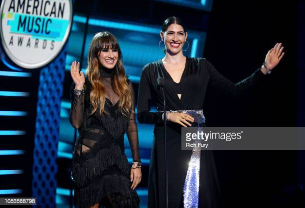 Hanna Nicole Perez Mosa and Ashley Grace Perez Mosa of Ha*Ash speak onstage during the 2018 Latin American Music Awards at Dolby Theatre on October...