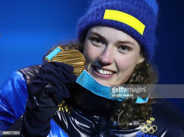 Hanna Oberg from Sweden showing her gold medal during the award ceremony of the women's 15km biathlon event of the 2018 Winter Olympics in...