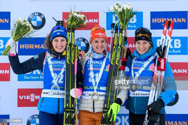 Hanna Oeberg of Sweden Denise Herrmann of Germany and Anais Bescond of France at the medal ceremony during the Women 15 km Individual Competition at...