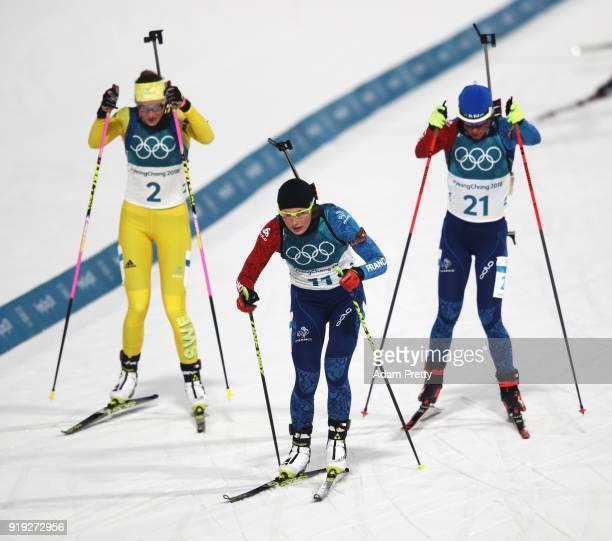Hanna Oeberg of Sweden, Justine Braisaz of France and Marie Dorin Habert of France compete during the Women's 12.5km Mass Start Biathlon on day eight...
