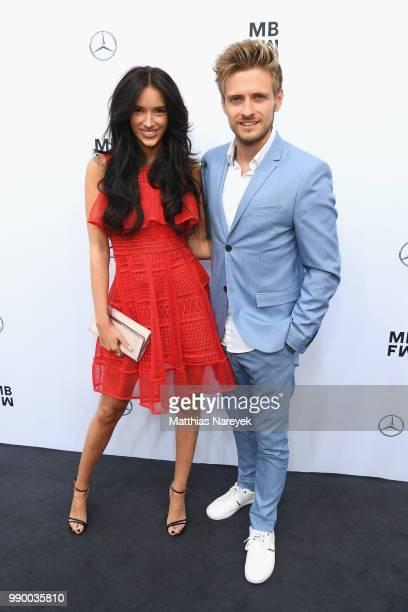 Hanna Weig and Joern Schloenvoigt attend the Guido Maria Kretschmer show during the Berlin Fashion Week Spring/Summer 2019 at ewerk on July 2, 2018...