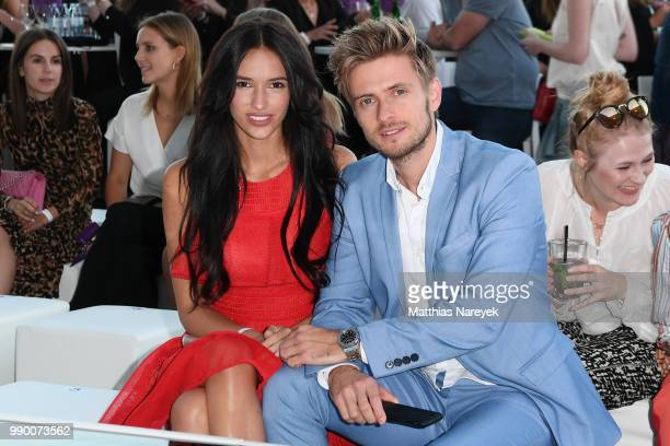 Hanna Weig and Joern Schloenvoigt attend the Lascana show during the Berlin Fashion Week Spring/Summer 2019 at Hotel nhow on July 2, 2018 in Berlin,...