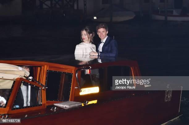 Hannah Bagshawe and Eddie Redmayne arrive at OMEGA Aqua Terra Palazzo Pisani Moretta on October 28 2017 in Venice Italy