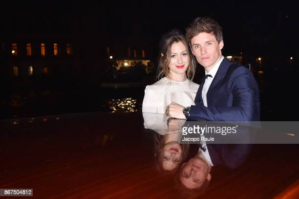 Hannah Bagshawe and Eddie Redmayne arrive at OMEGA Aqua Terra Palazzo Pisani Moretta on October 28 2017 in Venice Italy