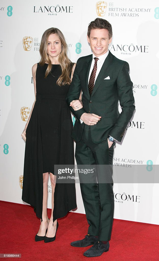 Hannah Bagshawe and Eddie Redmayne attend the Lancome BAFTA nominees party at Kensington Palace on February 13, 2016 in London, England.