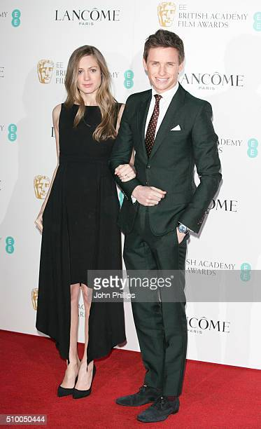 Hannah Bagshawe and Eddie Redmayne attend the Lancome BAFTA nominees party at Kensington Palace on February 13 2016 in London England