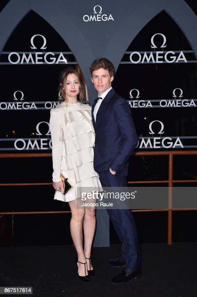 Hannah Bagshawe and Eddie Redmayne attend the OMEGA Aqua Terra at Palazzo Pisani Moretta on October 28 2017 in Venice Italy